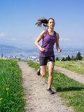 Young fit woman running in spring Stock Photo