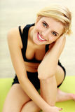Young fit woman smiling on camera Royalty Free Stock Images