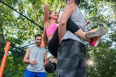 Young fit woman smiling while doing crunches with her partner du Stock Photo