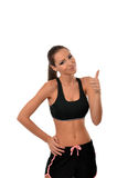 Young fit woman in sport gear giving thumbs up Royalty Free Stock Photos