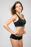 Young fit woman in sports outfit Royalty Free Stock Image