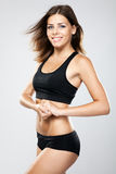 Young fit woman in sports outfit Stock Photo