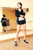 Young fit woman standing. At gym Stock Photo