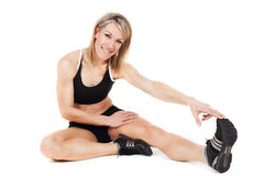 Young fit woman stretching Stock Photo