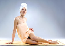 A young and fit woman after taking a bath Royalty Free Stock Photo