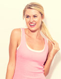 Young fit woman in tank top Stock Photography