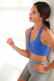 Young fit woman training with dumbbell Stock Photo