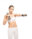 A young and fit woman training with dumbbells Stock Photography