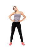 Young fit woman warming up and stretching neck looking at camera Royalty Free Stock Photography
