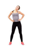 Young fit woman warming up and stretching neck looking up Stock Photography