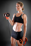 Young fit woman working out Stock Images