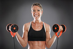 Young fit woman working out Royalty Free Stock Photos