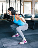Young fit woman working out with barbell Stock Photo