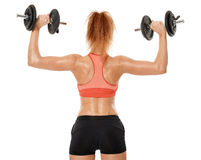 Young fit woman working out with dumbbells Royalty Free Stock Photography