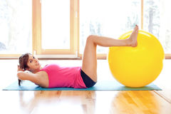 Young fit woman working out Royalty Free Stock Image