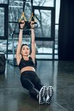 young fit woman working out with suspension straps royalty free stock photos