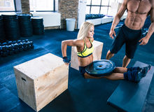 Young fit woman workout at gym Stock Photo