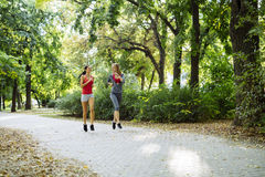 Young fit women jogging outdoors Stock Photo