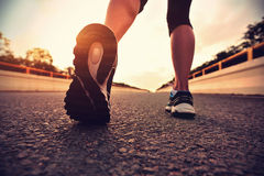 Young fitness asian woman runner legs Stock Images