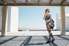 Young fitness blondy woman in sportswear listening music Royalty Free Stock Images