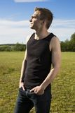 Young fitness coach looking at the sun Royalty Free Stock Photography