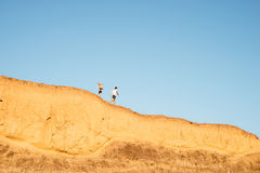 Young fitness couple jogging on a hill. Young fitness couple jogging together on a hill royalty free stock photos