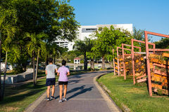 Young fitness couple  jogging in park Royalty Free Stock Photos