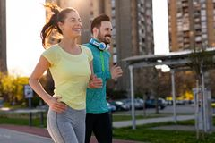 Young fitness couple running in urban area Royalty Free Stock Images