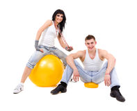 Young fitness couple wearing jeans in the studio Royalty Free Stock Photo