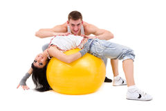 Young fitness couple wearing jeans in the studio Royalty Free Stock Images
