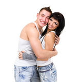 Young fitness couple wearing jeans in the studio Stock Images