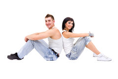 Young fitness couple wearing jeans in the studio Royalty Free Stock Photos