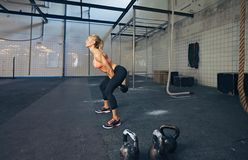 Young fitness female doing crossfit workout stock photo