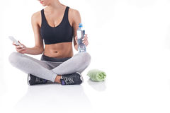 Young fitness girl after exercise Stock Photos