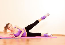 Young   fitness girl exercising Royalty Free Stock Photo