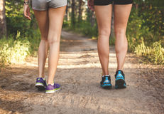 Young fitness girl legs at forest trail at sunset. Sporty women Stock Photo