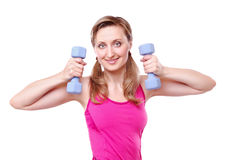 Young fitness girl making exercises stock photography