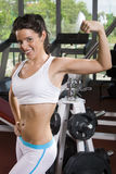 Young fitness girl posing. In the gym Royalty Free Stock Photos