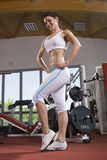Young fitness girl posing. In the gym Stock Photos
