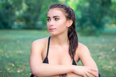 Young fitness girl rests during training Stock Photo