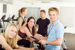 Young fitness instructor gym people spinning Stock Images