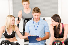 Young fitness instructor gym people spinning royalty free stock photos