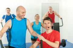 Young fitness instructor lead class alpinning Stock Images