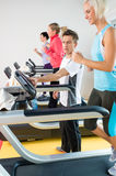 Young fitness instructor woman running at gym Stock Images