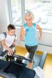 Young fitness instructor woman running at gym Stock Image
