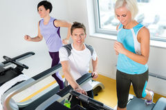Young fitness instructor woman running at gym Royalty Free Stock Images