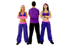 Young Fitness Instructors. Against white background in studio Royalty Free Stock Photo