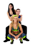 Young Fitness Instructors. Against white background in studio Royalty Free Stock Photography