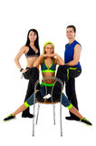 Young fitness instructors. Against white background Stock Photo