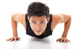 Young fitness man exercising push up Royalty Free Stock Images